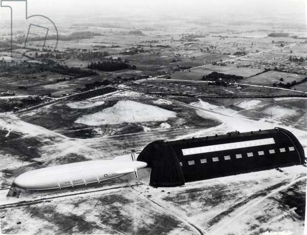 The U.S. Navy airship Akron emerging from the Goodyear Zeppelin hangar at Akron, Ohio, 1931 (b/w photo)