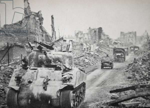 The capture of Aachen: tanks and trucks of the US First Army enter the shattered city, 21st October 1944 (b/w photo)