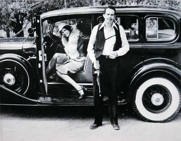 Warren Oates (1928-82) in the title role and Michelle Philips (b.1944) as Billie Frechette in 'Dillinger', 1973 (b/w photo)