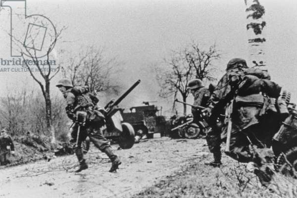 The German attack begins, SS infantry advancing, December 1944 (b/w photo)