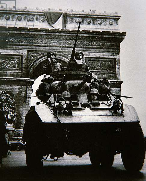 Americans in an armoured car pass the Arc de Triomphe, August 1944 (b/w photo)