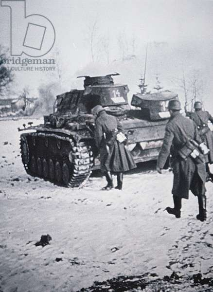 Infantry in greatcoats advance behind Pzkw III tank, during the German invasion of Russia, winter 1942 (b/w photo)