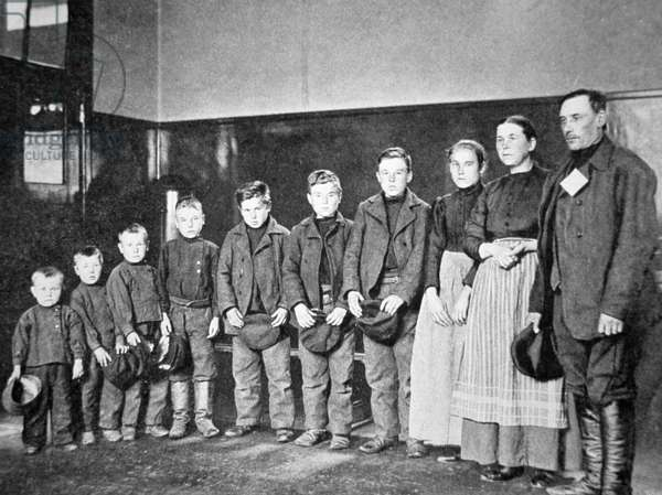A migrant Polish family at Ellis Island, New York, 1910 (b/w photo)