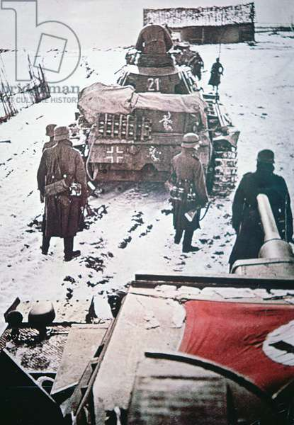 Pzkw III tanks of the 11th Panzer Division followed by Panzer grenadiers advance with caution into a Russian village, during the German invasion of Russia, winter 1942 (photo)