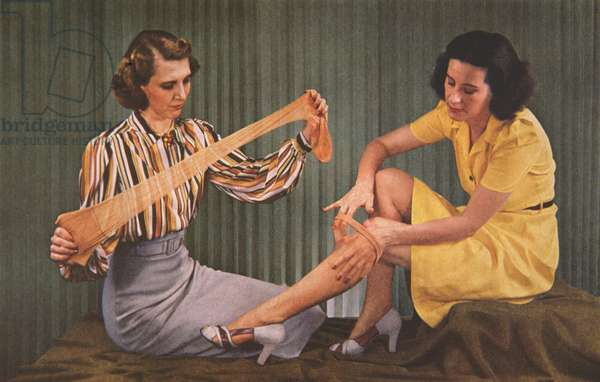 Women testing Nylon stockings made of the new material developed by DuPont, 1939 (photo)