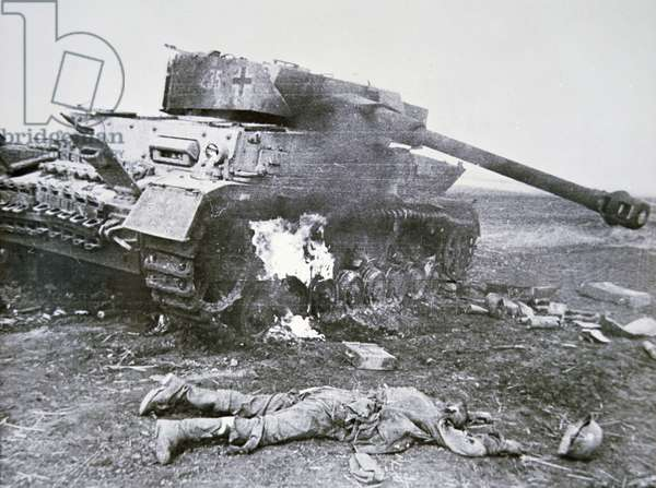 Wrecked German PzKw IV tank and dead soldier, Battle of Kursk, 1943 (b/w photo)