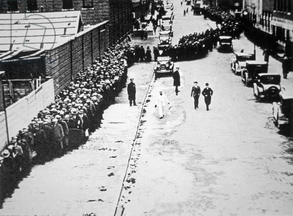 Unemployed workers standing in a breadline, New York City, c.1931 (b/w photo)