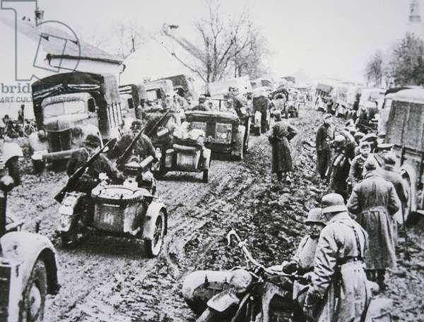German troops passing through a Yugoslav village, 1942 (b/w photo)