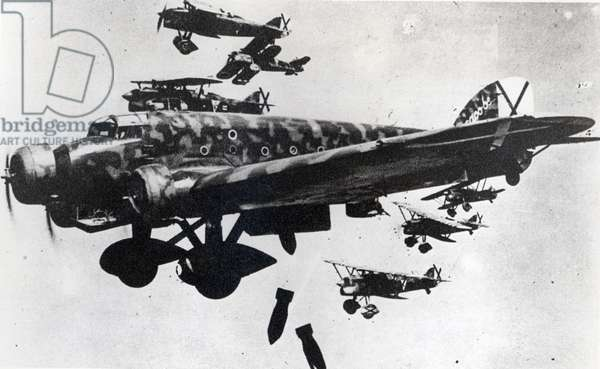 Italian aircraft (CR 32) dropping bombs in Spain during the Spanish Civil War (1936-39) (b/w photo)