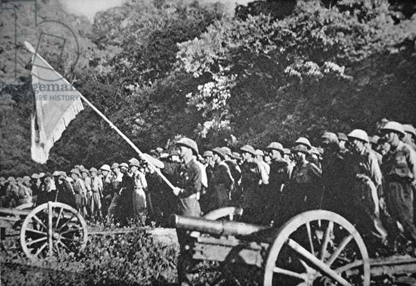 Communist Viet Minh troops on parade with light field artillery, during the siege of Dien Bien Phu, November 1953-May 1954 (colour litho)