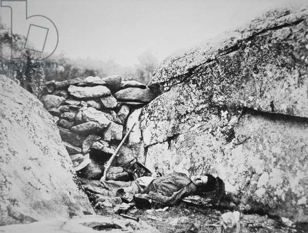 Dead Confederate sharpshooter at Round Top, Gettysburg, July 1863 (b/w photo)