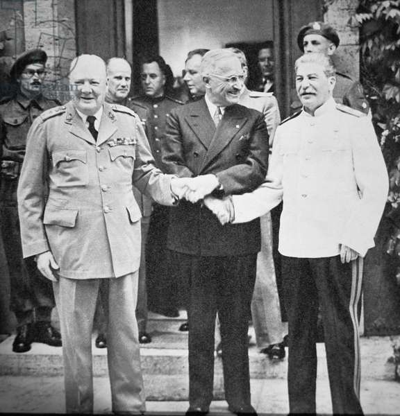 Winston Churchill (1874-1965) President Truman (1884-1972) and Joseph Stalin (1879-1953) shaking hands at the Potsdam Conference, July 1945 (b/w photo)