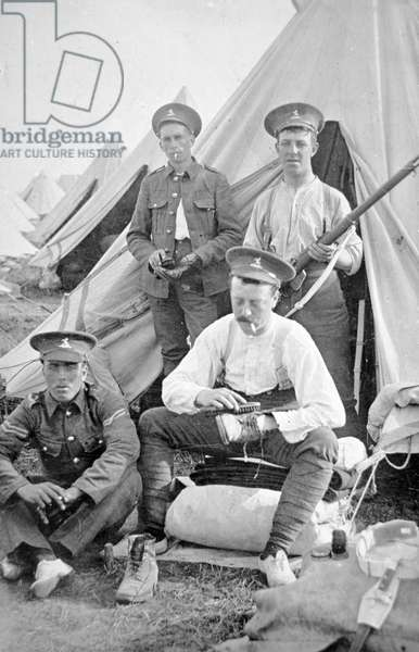 British soldiers in camp cleaning their kit, 1914 (b/w photo)