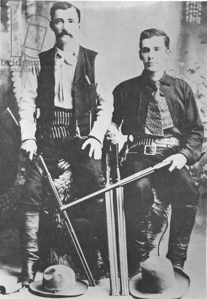 Wells Fargo stagecoach messengers armed with shotguns and Winchester repeating rifles (b/w photo)