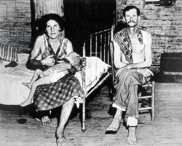 Poverty-stricken American, Bud Fields, with his wife and daughter, Hale County, Alabama, 1938 (b/w photo)