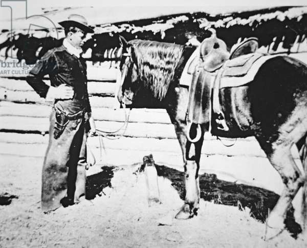 Butch Cassidy (1866-1908/09) with his horse (b/w photo)