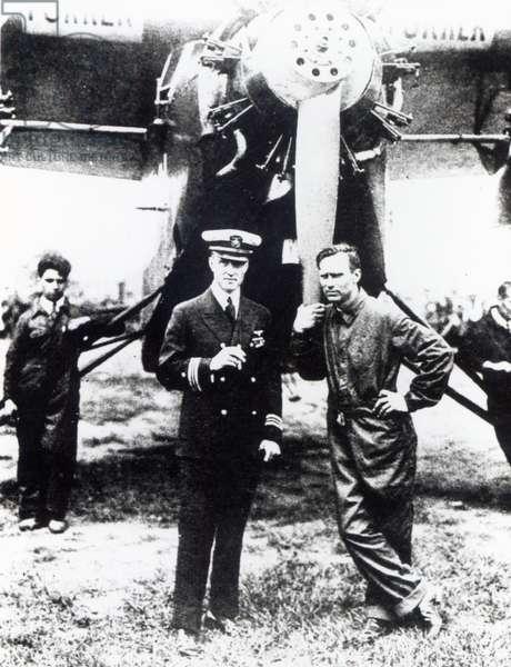 Richard Evelyn Bird and Floyd Bennett pose before the 'Josephine Ford' (b/w photo)