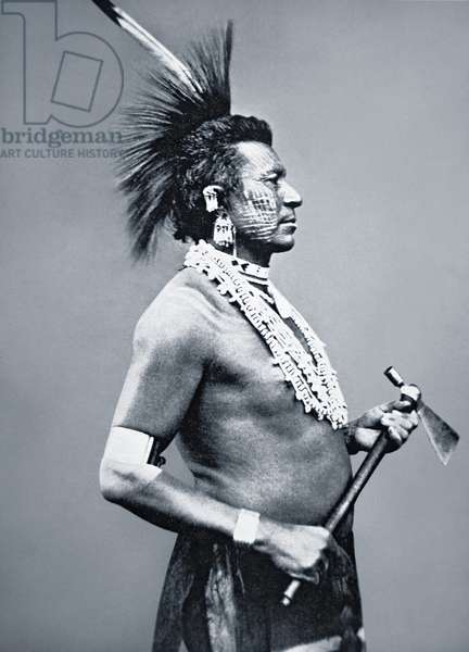 Osage Tribe Warrior with tomahawk pipe, c.1875 (b/w photo)