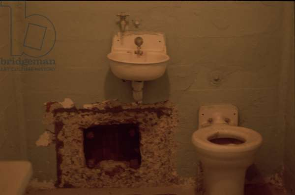 Cell with escape tunnel behind false grille, Alcatraz Prison, San Francisco, 1992 (photo)