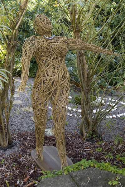 Lifesize sculpture of a woman (willow & recycled drinks cans)