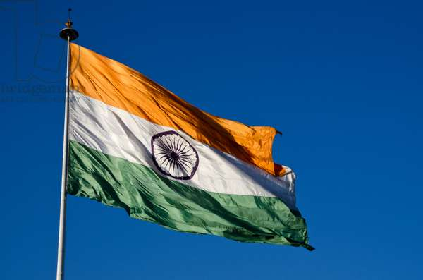 Large National Flag of India billowing in wind, Connaught Place, New Delhi, India (photo)