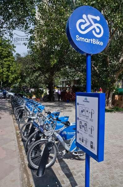 SmartBikes for rent on city street, New Delhi, India (photo)