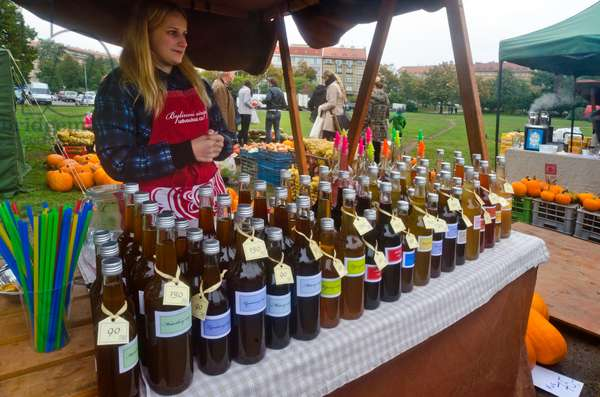 Farmers' Market on open space in historical city quarter, herbal syrup stall, Dejvice, Prague, Czech Republic(photo)