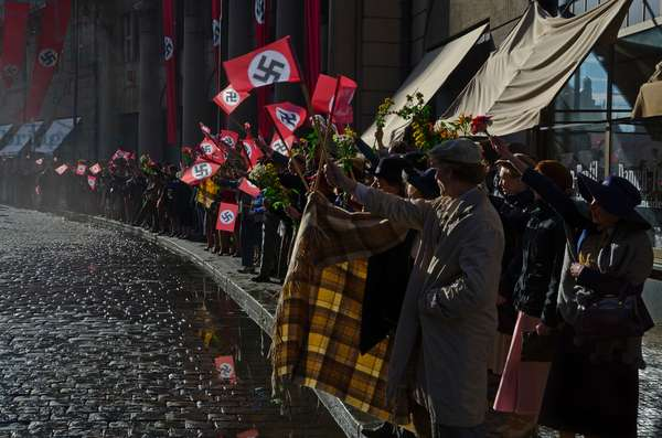 Filmset in Prague: Crowd of citizens with swastika flags lining city street to welcome Nazis, (Chinese production), Senovazne Square, Prague, Czech Republic(photo)