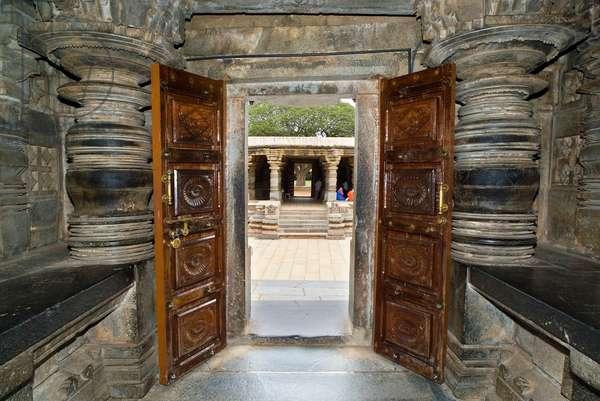 Lathe-turned stone pillars at the entrance to the Keshava Vishnu temple (photo)