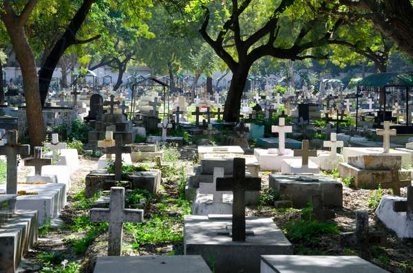 Graves in Indian Christian cemetery, Paharganj, New Delhi, India (photo)