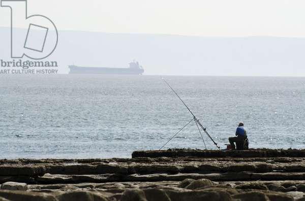 Glamorgan Heritage Coast: Sea Angler Fishing, near Nash Point, Vale of Glamorgan, West of Llantwit Major, South Wales, UK (photo)