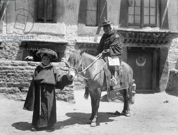 The Dalai Lama's aide–de–camp, Tsendron Kusho, on a horse being led by attendant, c.1920-21 (glass plate gelatin print)