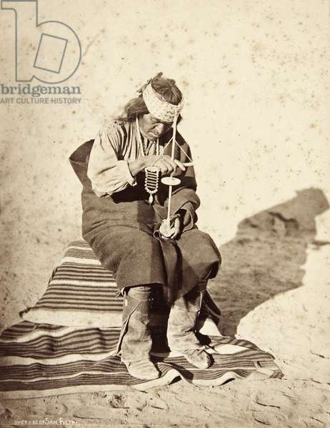 Portrait of the Governor of San Felipe pueblo demonstrating the use of a pump–drill, 1880 (albumen print)
