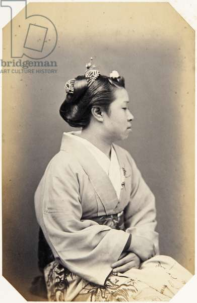 Profile portrait of a seventeen–year–old Japanese girl (named Sumi), a geisha, sitting, wearing traditional dress of kimono, 1867 (albumen print)