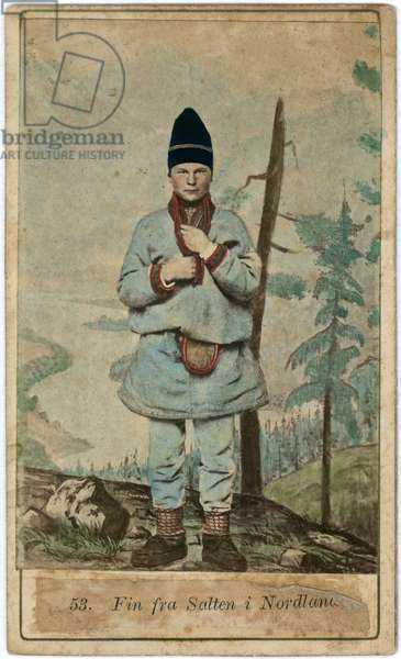 Full length portrait of a boy wearing heavy–weight tunic and trousers, a purse at his belt and a high hat.  He is set against a landscape, which is looks like a studio background, c.1870s (hand-tinted albumen print)