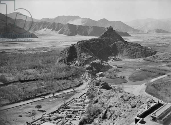 View south west from the roof of the Potala looking towards Chakpori, or Medicine Hill, Lhasa, Tibet, 22nd November 1936 (b/w photo)