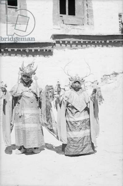 Two masked dancers wearing ritual robes and holding ritual implements, Gyantse, Tibet, c.1936-50 (b/w photo)