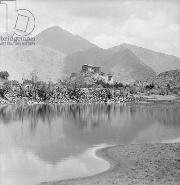 The Potala Palace from the west with the Kyichu river in the foreground, c.1936-50 (b/w photo)