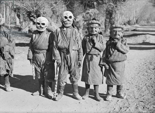 Group of Lhasa mummers, all masked, who came to the Dekyi Lingka to perform, where the British Mission under Sir Basil Gould was staying, Lhasa, Tibet, 1st Decemeber 1936 (b/w photo)