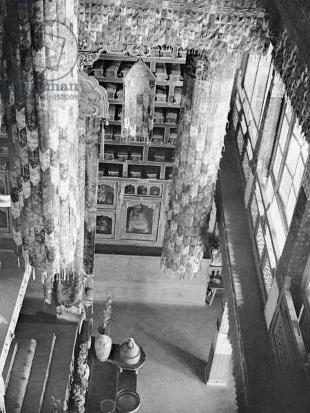 Looking down on part of the 13th Dalai Lama's tomb in the Potala Palace from an upper gallery, with appliqué victory banners made of brocade, Lhasa, Tibet, 22nd November 1936 (b/w photo)