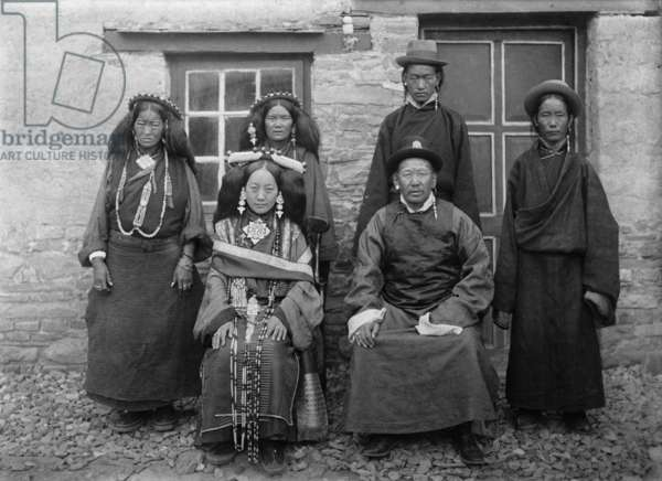 Kusho Doring and his wife with members of their household standing behind them, 1920 (glass plate gelatin print)