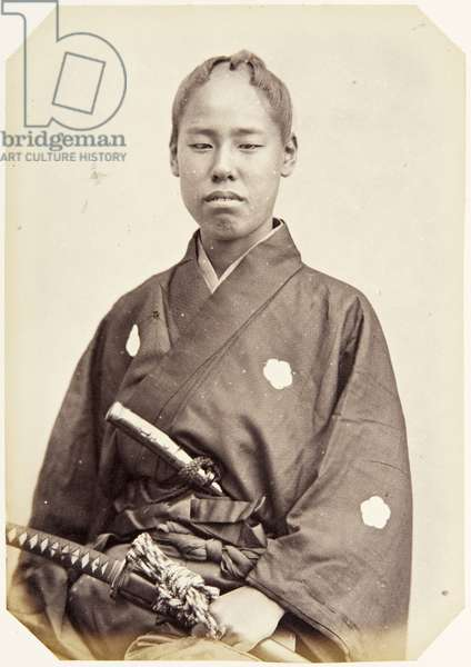 Portrait of a sixteen–year–old Japanese youth named Miyake Shūzō, a samurai and member of the 1864 Ikeda mission to France, employed as a personal attendant of the first secretary, 1864 (albumen print)