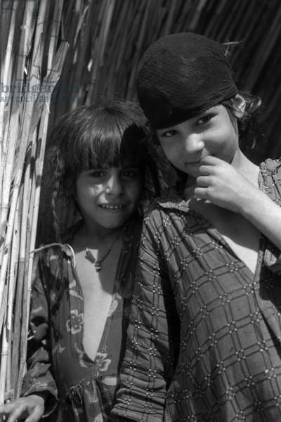 Portrait of two girls, the sisters of Amara bin Thuqub and Sabaiti bin Lazim, two of Wilfred Thesiger's canoe-boys, Iraq, 1958 (b/w photo)