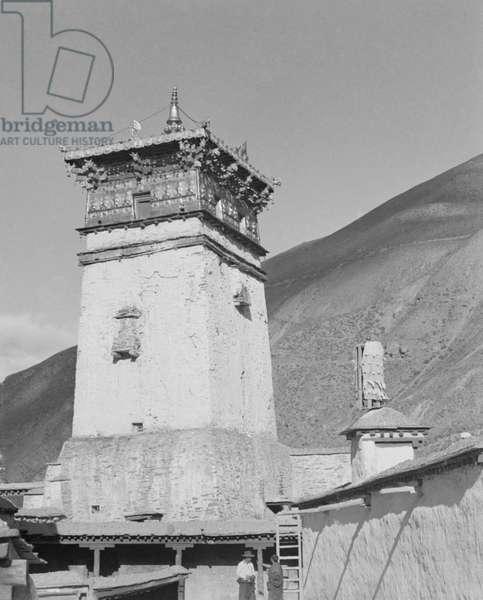 Tower at Sekhar Gutog Monastery in Lhodrag near the Bhutan border, Tibet, 1950 (b/w photo)