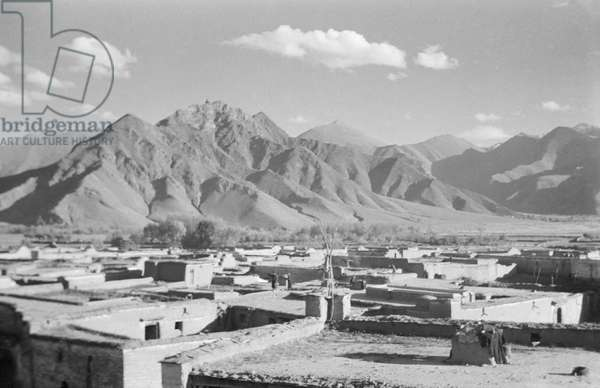 View of rooftops in the hamlet of Sho at the foot of the southern face of the Potala, Lhasa, Tibet, September-December 1936 (b/w photo)