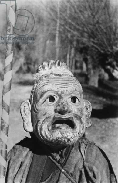 Lhasa mummer in mask, close–up, performing in the grounds of the British Mission residency in the Dekyi Lingka, Lhasa, Tibet, 1st December 1936 (gelatin silver print)