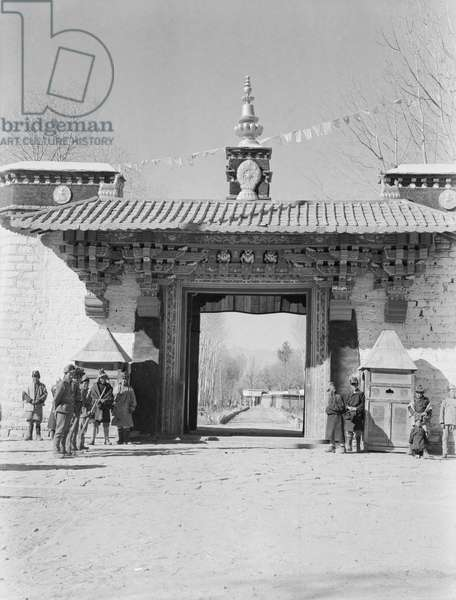 The gateway to the Norbu Lingka with the main building visible through the entrance, Lhasa, Tibet, December 1936 (b/w photo)