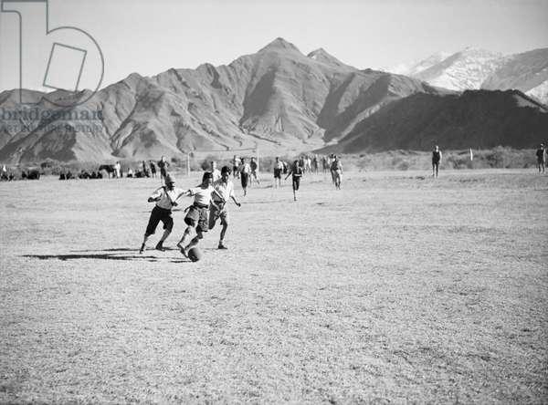Playing seven-a-side football on a field near the Norbu Lingka, Lhasa, Tibet, 9th November 1936 (b/w photo)