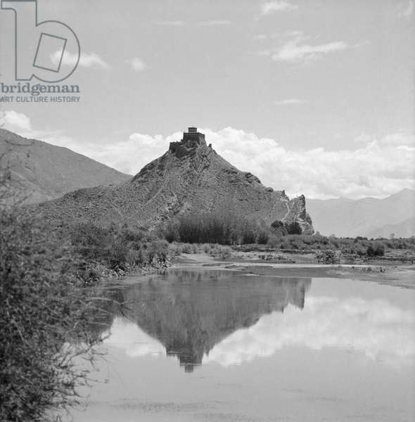 Chakpori reflected in the waters of the Kyichu river, Lhasa, Tibet, 1939 (b/w photo)