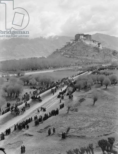 The Potala Palace from the south west with spectators lining the route, Lhasa, Tibet, 6th October 1936 (b/w photo)